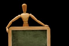 Educated mannequin. Blank chalkboard royalty free stock image