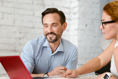 Educated middle aged couple communicating at home Stock Image