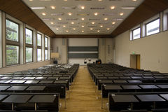 Education. Lecture hall with blackboard / projector in the front Royalty Free Stock Photo