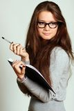 Education. Portrait of the young woman with the daily log in hands Stock Photos