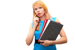 Education. Portrait of the young girl in a dark blue dress, as the education concept Royalty Free Stock Photography