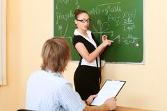 Education. Al theme: college teacher giving a lecture to students royalty free stock photo