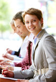 Education. Group of happy successful people in line with focus on woman Royalty Free Stock Images