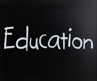 Education. Image of Education handwritten with white chalk on a blackboard Royalty Free Stock Photos