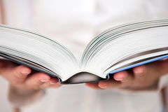 Education. An open study book being read - shallow dof Stock Photography