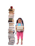 Education. Going to school is your future. Education, learning, teaching. A girl holds a pile of books with a tower of books beside her Stock Photos