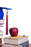 Education. Going to school is your future. Education, learning, teaching. A graduation cap with an apple Stock Images