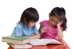 Education. Going to school is your future. Education, learning, teaching. Two sisters share a book Stock Photography