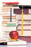 Education. Going to school is your future. Education, learning, teaching. A graduation cap with an apple. Focus on Tassel Stock Image