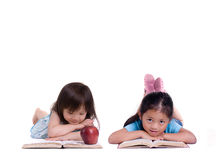 Education. Going to school is your future. Education, learning, teaching. Two young girls reading books Royalty Free Stock Photo