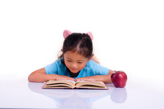 Education. Going to school is your future. Education, learning, teaching. A young girl reads a book and thinks about her future Royalty Free Stock Images