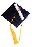 Education. A graduation cap, diploma and pencil Stock Image