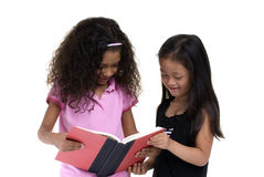 Education. Going to school is your future. Education, learning, teaching. Two young girls share a book Stock Images