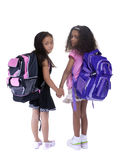 Education. Two young girls are ready for the first day back to school Royalty Free Stock Image