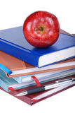 Education. An apple placed on top of some books - education concept Stock Images
