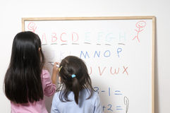 Education. Two young girs getting ready for school. Education, Future Royalty Free Stock Photos