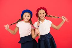 Education abroad. Apply form enter international school. French language school. School fashion concept. Pupil smiling. Girls wear formal uniform and beret hats stock photography