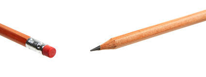 Education abstract. Close up image of the two ends of a crayon over white background Stock Images