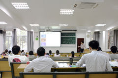 Education. Adult education teacher in front of his class in the sun yat seen university in Guangzhou China stock photos