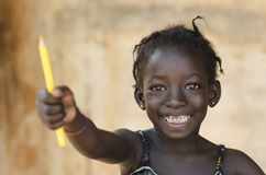 Education for Africa Symbol: Beautiful Young Schoolgirl Toothy S. Mile Royalty Free Stock Images