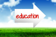Education against blue sky over green field. The word education and arrow against blue sky over green field Royalty Free Stock Photography
