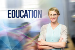 Education against confident female teacher in computer class. The word education against confident female teacher in computer class royalty free stock photos