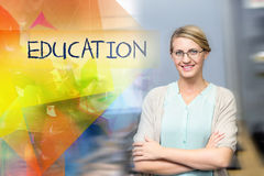 Education against confident female teacher in computer class Stock Image