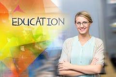 Education against confident female teacher in computer class. The word education against confident female teacher in computer class Stock Image