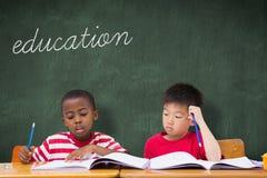 Education against green chalkboard Stock Image