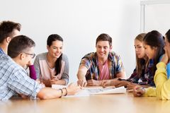 Group of smiling students meeting at school stock images