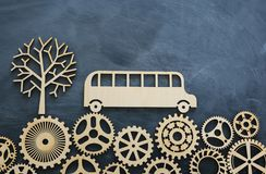 Education and back to school concept. Top view photo of school bus over wooden gears as concept of success and achievement and. Classroom blackboard background royalty free stock photos
