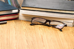 Education book and glasses on wooden table .vignetting style Royalty Free Stock Photo