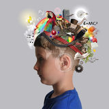 Education Boy with School Subjects on Mind. A child has various education and school objects on his head with a isolated background. Subjects are art, science Royalty Free Stock Photo