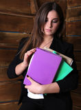 Education, business. Young girl in a business suit holding a few books. Books in raznovetnyh covers. Brunette Stock Photos