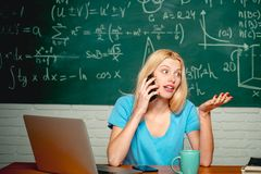 Education and campus people concept. Unhappy student working on laptop. Nerd funny student preparing for university. Exams royalty free stock photo
