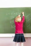 Education - Child at blackboard in school Royalty Free Stock Photos