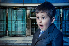 Education, child dressed businessman with hands in his tie and s Royalty Free Stock Photo