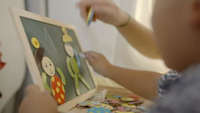 Education of a child with game and drawing stock video footage