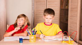 Education, childhood, people, homework and school concept - children doing homework