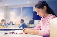 Happy girl building robot at robotics school Royalty Free Stock Photos