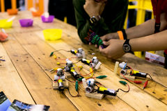 Education circuit and motor activity. Tinkering area with batteries, motor dc and trash robot stock image