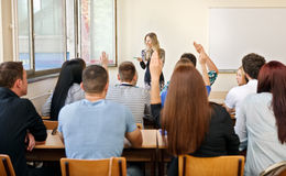 Education class raising hands Royalty Free Stock Photo