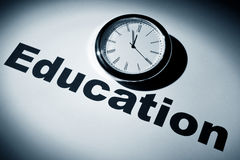 Education. Clock and word of Education for background Stock Photos