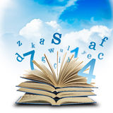 Education concep. The Magic Book and the letters on a sky background. Education concep Royalty Free Stock Photos