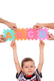 Education concept. Hands holding puzzle with ABCD letters isolated on white Royalty Free Stock Photos