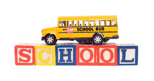Education Concept. Concept image of education using a toy school bus and baby letter blocks, isolated against a white background Stock Photography