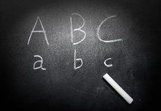 Education concept ABC alphabet on blackboard.  Royalty Free Stock Photography