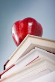 Education concept with apple and books. Education concept with red apple and pile of books books stock photo