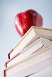 Education concept with apple and books Stock Photos