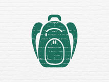 Education concept: Backpack on wall background Royalty Free Stock Images